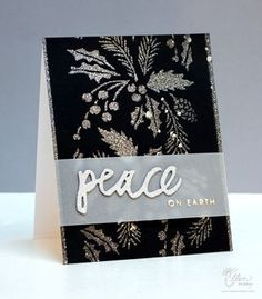 "handcrafted Christmas card ... black with silver glitter and a translucent vellum band ... PeaceonEarthStencil ... ""peace"" die cut from silver glitter paper ... background created with stencil and spraying silver stain ... elegant and gorgeous look!"