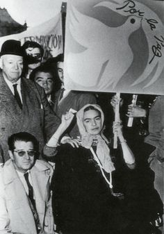 "mimiwao: Frida's last public appearance, on July 2, 1954, at a rally protesting C.I.A. involvement in Guatemala. Diego is behind her. Juan O'Gorman to her right. ""What is interesting, is that the Frida Kahlo venerated by American feminists is a very different Frida Kahlo to the one people learn about in Mexico, in the Chicano community. In her country, she is recognized as an important artist and a key figure in revolutionary politics of early 20th"