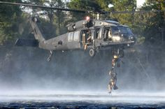 Photo showing USAF Pararescumen climbing a rope ladder up to a helicopter flown by the SOAR. Air Force Pararescue, Usaf Pararescue, Special Ops, Special Forces, Military Helicopter, Military Aircraft, Uss Nimitz, Aviation Humor, Tactical Life
