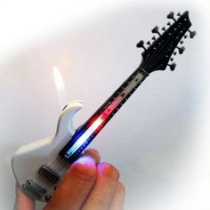 Mini Guitar LED Light Lighter Refillable Cigar Cigarette Lighter will get everyone's attention. Makes a perfect gift for smoker who likes music and cool lighters. 2 Lighters per order Please allow two weeks for shipping