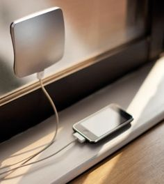 XDModo Solar Charger ~ sticks to window and charges cell phone using solar power.