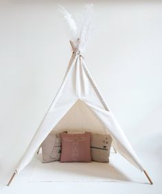 A TIPI FOR YOUR OWN LITTLE INDIAN!    This White Cotton Tipi is especially made for children to discover their imaginary world. Its an addition