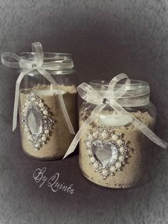 DIY: creative way to re-use a jar. Put some sand in the jar, decorate with stones, pearls and a nice ribbon and finally a candle in it. Easy and very nice!