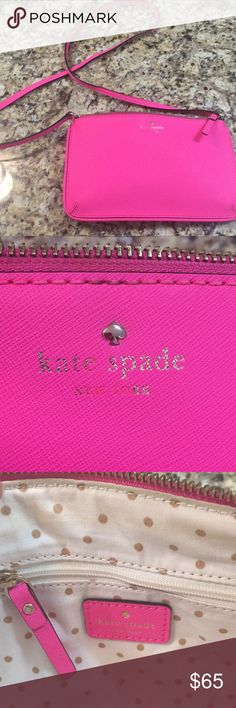 Kate Spade crossbody bag Bright pink leather Kate Spade cross body bag. Slight fading on the outside logo and minor stain on the interior. Both are pictured. Posted a picture with my hand for size comparison. kate spade Bags Crossbody Bags