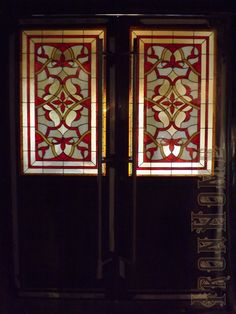 "stained glass doors and windows at front entrance of the ""zamok"