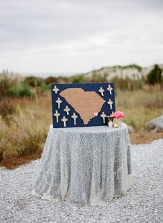 South Carolina love in this unique seating chart | The perfect amount of vintage flare for a beach wedding at Charleston's Island Resort #wilddunesweddings bit.ly/1ZuZSd7