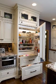 This is a wonderful example of how cabinet fronts can cloak a refrigerator's door and two freezer drawers, especially when cabinets are also built in above the appliance. #housetrends