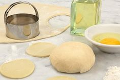 A pretty good perogy dough recipie.  Under the direction of my Polish grandmothers, try only using the egg yolk (leave out the whites)...they can tend to make the dough a little rubbery.