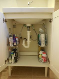 Move the shower caddies under the sink for storage that will actually stay de-cluttered.