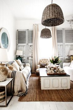 gorgeous living room with shutters and basket lights wood floors sisal rug