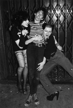 Stiv Bators of The Dead Boys was never the guy who would turn down a friendly offer to share some chewing gum with Hellin Killer & Trudie Arguelles, as documented by Ebet Roberts in 1977 in front of CBGB's.