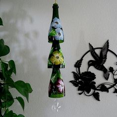 Champagne bottle windchime, green wind chime, colorful flowers, yard art, patio decor, recycled bottle wind chime, hand painted chime by LindasYardArt on Etsy