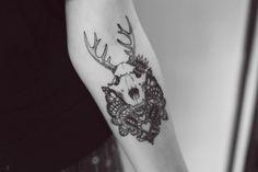 skull antlers arm tattoo