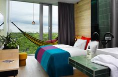 A hammock and a view of a treetop canopy bring the tropics to the downtown 25 Hours Hotel Bikini Berlin. In the en suites the GROHE Euphoria shower systems complete the urban jungle theme. #hotel #bathroom #GROHE #Germany http://www.grohe.co.uk/en_gb/bathroom-collection/showers-euphoria-systems.html 25h Hotel Berlin Werner Aisslinger Design