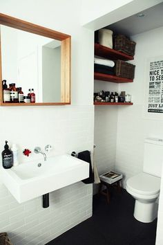 Love the framed inset mirror - I need a shelf like that above my sink #GreatInteriorDecoratingStyles