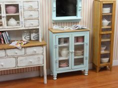 Pretty blue cabinet by Lori's Little Things