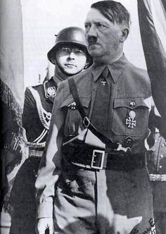 Of COURSE: Himmler standing BEHIND Hitler. The fucking coward was such a pansy that he always stood behind SOMEONE--never had his own dick.