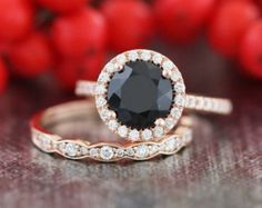 This wedding ring set showcases a halo engagement ring with a 8x8mm cushion cut natural black spinel set securely in a solid 14k white gold halo