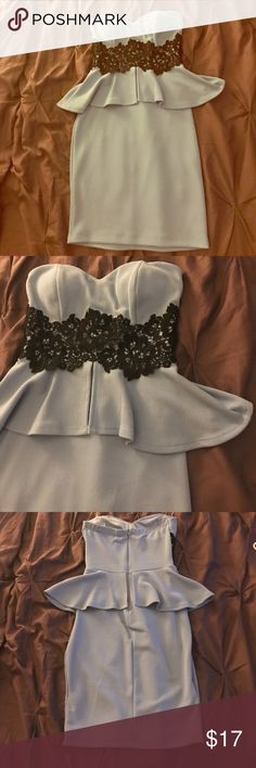 Light blue and black peplum dress Size small. Hope's brand. Never worn. Light blue and black peplum dress. Dress sits right about knee length for me and I am 5'2. Lined bust and padding. Hope's Dresses Midi