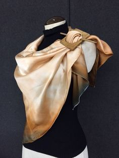 "This striking large wrap measures 44"" x 44"" and is sure to turn heads. Adorned with beautiful tones of sepia and black, showcasing a delicate equine design in the center. 100% Luxurious silk charmeuse"