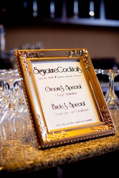 bride and groom drink of choice sign by bar at wedding reception #weddingreception #weddingsigns #weddingchicks http://www.weddingchicks.com/2014/01/30/pink-and-peach-bejeweled-wedding/