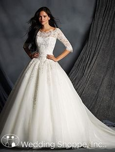 Tulle ball gown with illusion neckline and elbow length lace sleeves.