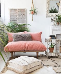 Gorgeous blush pink and cream colour palate in this living space. Love the small pink sofa, Moroccan pouf and beni ourain rug. The plants and macrame plant hanger add a boho vibe.