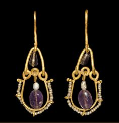 """archaicwonder:"""" Byzantine Gold, Amethyst and Pearl Earrings, Century AD Byzantine jewellery was a full continuation of the Roman traditions which were kept alive at the new capital, Constantinople, as well as other centers of artistic. Byzantine Gold, Byzantine Jewelry, Renaissance Jewelry, Medieval Jewelry, Ancient Jewelry, Victorian Jewelry, Antique Jewelry, Wiccan Jewelry, Viking Jewelry"""