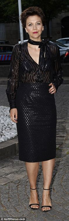 Bit of sparkle: Maggie Gyllenhaal looked chic in a pencil skirt and glittery sheer shirt w...