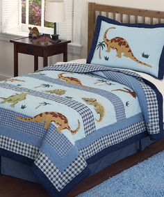 Inspire prehistoric sweet dreams with this dinosaur quilt set. Handcrafted from super-soft materials, it's the perfect place tuckered-out T-rex to grab a few z's.Includes quilt, two shams and bed skirtTwin: includes quilt, sham and bed skirtAvailable in two sizesFace: 100% cotton...