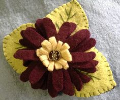 Hat, scarf, or lapel flower the options are endless for this maroon ECO-friendly felted wool pin. by UpcycleDesignsByDana on Etsy