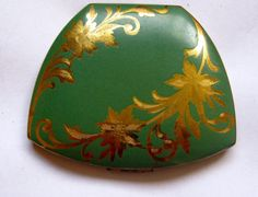 Green, gold vintage compact
