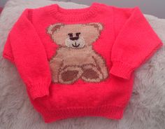"""A pretty smiley teddy for your delight today. This happy little bear is sat on a 22""""/ 56cm chest machine washable acrylic jumper to keep your little one cosy and warm all winter at £12.00 + £4.25 signed delivery. Message me for any further details or to order.  See him in Crafters' Corner, Littlehampton if you are local to us in West Sussex."""