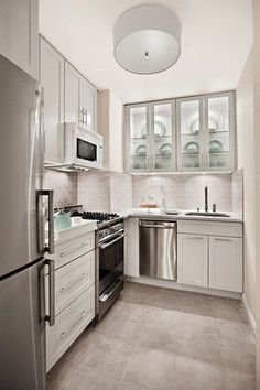 5 Endless ideas: 1970 Kitchen Remodel On A Budget small kitchen remodel boho.Cheap Kitchen Remodel Before After small kitchen remodel cost. Small White Kitchens, Small Kitchen Layouts, Narrow Kitchen, Small Space Kitchen, Small Spaces, Island Kitchen, Kitchen Countertops, Tiny Kitchens, Kitchen Cabinets