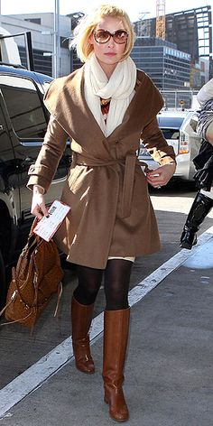 KATHERINE HEIGL  It's a wrap for the One for the Money star, who pairs a brown shawl-collar Gerard Darel coat with a cognac Rebecca Minkoff satchel and knee-high boots for a color-coordinated LAX arrival.