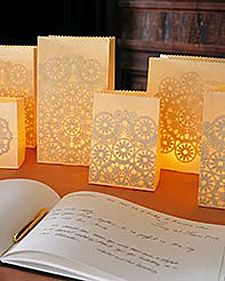Give the decorations at your wedding reception the romantic look of lace. The intricate patterns shining through these luminarias (paper-bag lanterns illuminated by votive candles) are courtesy of doilies glued inside. Place a grouping of the lanterns in different sizes on the guest-book table or dinner tables for a beautiful, glowing display. We chose ivory paper bags for an understated look, but you can use thin paper bags in any light color.