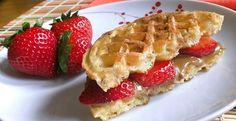 Waffle PBJ-Wich Try this sweet take on a classic breakfast sandwich the next time eating on the go. Prepare 1 whole-grain toaster waffle and slice in half. Spread with 2 tablespoons nut butter and layer 2-3 sliced strawberries on top in place of the traditional jelly (to cut down on sugar).