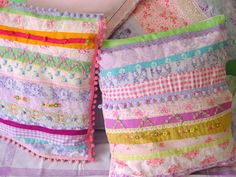Pillows, Selina Lake. Love these color combos; a touch of bright, saturated color really sets off the pastels.