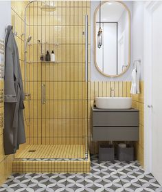 What an exquisite bath! I love the yellow shower tile with the gray patterned floor tile