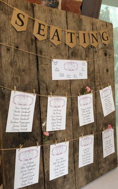 Rustic wooden boards for wedding table plans at Wasing Park