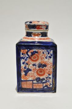 19th century Japanese Imari tea caddy, handpainted red, blue and gold floral decoration on cobalt blue square shape with cap lid, Meiji period c. late 1800s, porcelain, Japan