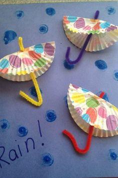 cupcake liners as umbrellas. Thumb print or construction paper drops.