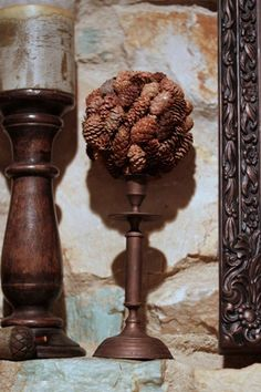 great idea, old candle stick holder, a styrofoam ball, and pinecones!