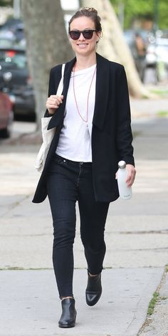 Olivia Wilde looked every bit the cool, casual mom-to-be in jeans, a tee, and a blazer.