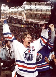 Wore 99 in Hockey because of The Great One. Seriously though, how do u score 212 points in an 82 game season?