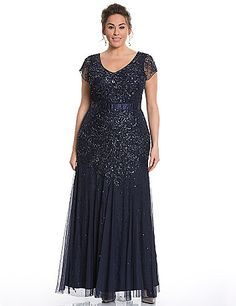 Exquisitely beaded & sequined gown by Adrianna Papell makes your arrival the highlight of the evening.  Dramatic and elegant for that special occasion, this beautiful number flatters with a V-neck and cap sleeves, with a satin waist to define hourglass curves. Fully lined. Hidden back zipper.  lanebryant.com