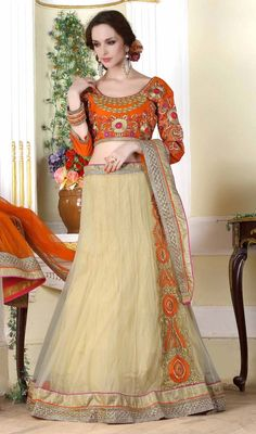 Make a style statement draped in this chiku color shade net embroidered lahenga choli. That you can see some intriguing patterns accomplished with lace and resham work. Upon request we can make round front/back neck and short 6 inches sleeves regular lahenga blouse also. #LatestWhiteAndOrangeFancyLehengaCholi