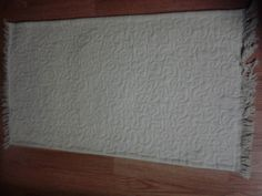 canvas drop cloth morphs into quilted rug the canvas drop cloths make wonderful curtains