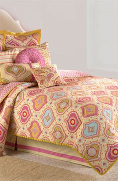 Bedding by Dena™ Designs. Brighten your boudoir with a color-burst cotton quilt that reverses to charming ditsy designs.