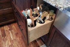 •❈• Mess-B-Gone  There's no denying it — a bunch of spatulas and big stirring spoons stuck in a canister on your kitchen counter always looks messy. But an experienced cabinetmaker may have some tricks up a sleeve. The makers of these cabinets devised a utensil drawer. They purchased stainless steel crocks ($15) online, and fitted them into circular holes cut into a plywood insert.